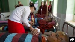 Buddhist monks are treated at a hospital in Monywa after a police crackdown on protesters at a controversial copper mine, Nov. 29, 2012.