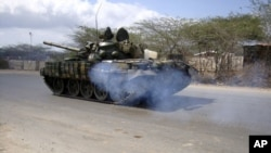 African Union Mission to Somalia (AMISOM) peacekeepers patrol in their tanks along a main road in Hodan district in of the capital Mogadishu, Somalia, March 4, 2011