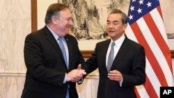 Ông Vương Nghị trong một cuộc gặp với Ngoại trưởng Mỹ năm 2018.