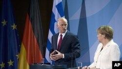 O Πρωθυπουργός Γιώργος Παπανδρέου με την Καγκελάριο Αγκελα Μέρκελ