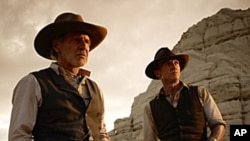 Cowboys vs. Aliens. Harrison Ford, Daniel Craig, Movie release July 29 2011.