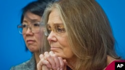 FILE - Gloria Steinem, right, and Christine Ahn of of WomenCrossDMZ listen during a U.N. news conference announcing plans for a women's walk across the demilitarized zone between North and South Korea to call for reunification, March 11, 2015.