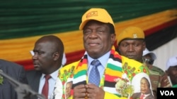 FILE - Zimbabwe's President Emmerson Mnangagwa addressing members of his Zanu PF party in Gweru town, about 350 kilometers south of Harare, May 31, 2018.