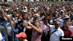 "Madagascar demonstrators from the opposition chant slogans as they protest after the president denounced unrest in which two people were killed as a ""coup"" intended to divide the country's people in Antananarivo, Madagascar, April 23, 2018."