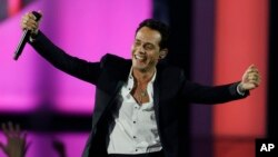 FILE - Singer Marc Anthony performs during the Latin Billboard Awards in Coral Gables, Florida, April 24, 2014.