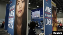 A visitor passes an exhibition at the International AIDS 2012 Conference in Washington