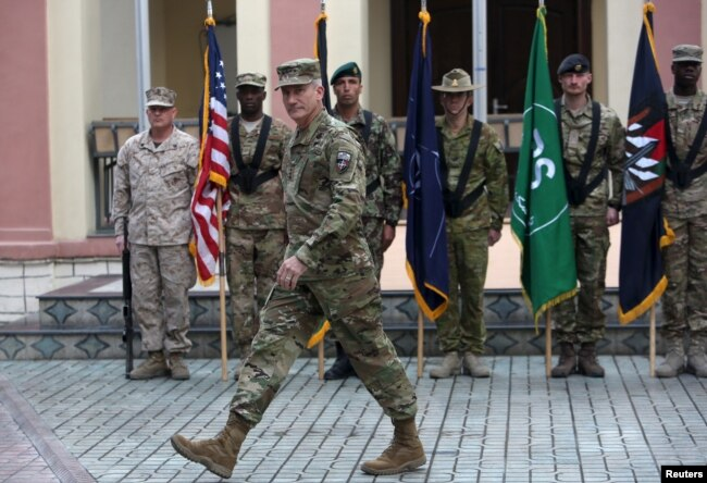 FILE - Commander of NATO Resolute Support forces and United States forces in Afghanistan, U.S. Army General John Nicholson walks during a change of command ceremony in Resolute Support headquarters in Kabul, Afghanistan, March 2, 2016. U.S.-led NATO forces ended their combat mission in Afghanistan at the end of 2014 but continue to provide training and support.