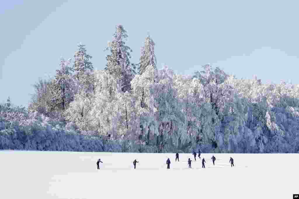Cross country skiers enjoy a freezing sunny afternoon near Nove Mesto na Morave, Czech Republic.