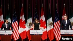 Canada's Foreign Minister Chrystia Freeland, center, addresses the media with Mexico's Economy Minister Ildefonso Guajardo, left, and U.S. Trade Representative Robert Lighthizer at the close of the third round of NAFTA talks involving the United States, Mexico and Canada in Ottawa, Ontario, Canada, Sept. 27, 2017.
