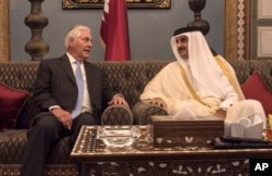 FILE - U.S. Secretary of State Rex Tillerson meets with the emir of Qatar, Sheikh Tamim bin Hamad Al Thani, at the Sea Palace in Doha, Qatar, July 11, 2017.