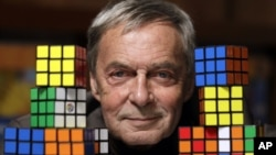 Erno Rubik, the inventor of the Rubik's Cube, poses at Liberty Science Center in Jersey City, N.J., April 25, 2012,