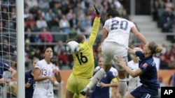 United States' Abby Wambach, center, scores during the Women's Soccer World Cup in Germany in 2011.