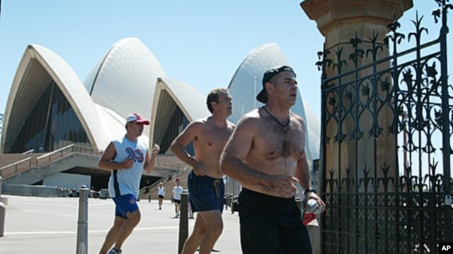 Lunch-time runners with their shirts off in the heat of the day pass through the old Botanical Gardens gates near the Sydney Opera House. Health authorities in Australia have appealed for a sense of vanity in an attempt to scare them into being more sun s