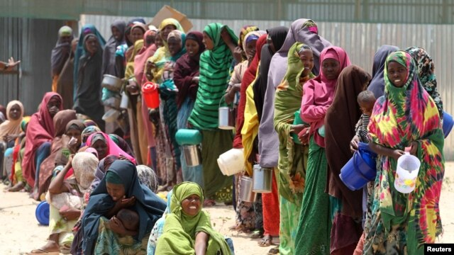 Internally displaced Somali women wait for relief food to be served in Hodan district south of capital Mogadishu in this September 5, 2011 photo.