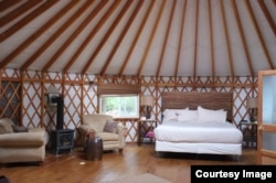 This is the wood-framed yurt where Lisa stayed on her glamping trip.