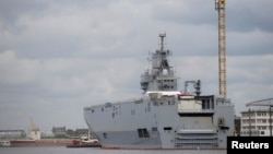FILE - One of the two Mistral-class warships Russia had ordered from France is seen at the STX Les Chantiers de l'Atlantique shipyard in Saint-Nazaire, western France, April 24, 2014.
