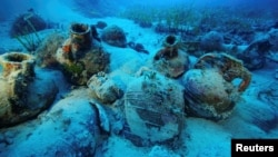 Amphorae are seen at the sea bottom at a shipwreck site on the island of Fournoi, Greece, September 15, 2018. Picture taken September 15, 2018. Vassilis Mentogiannis/Hellenic Ephorate of Underwater Antiquities/Handout via REUTERS