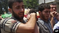 Похороны активиста ХАМАС убитого во время налета израильской авиации и артиллерии. Газа-Сити. 12 июля 2012 г.
