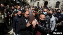Christian worshippers take part in a Good Friday procession along the Via Dolorosa amid eased coronavirus disease restrictions, during Easter Holy Week in Jerusalem's Old City April 2, 2021. (REUTERS/Ammar Awad)
