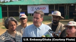 USAID Administrator Mark Green, center, speaks to reporters at the Balukhali Rohingya refugee camp in Cox's Bazar, Bangladesh. (File)