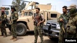 Para pejuang Lasykar Demokratis Suriah (SDF) yang didukung AS (foto: dok).