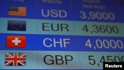 Rates of currencies, including British Pound, are displayed after Brexit referendum. June 24, 2016 (Reuters)