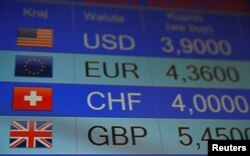 Rates of currencies, including British Pound, United States dollar, Euro and others displayed in London, June 24, 2016 (Reuters)