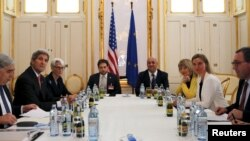 FILE - U.S. Secretary of Energy Ernest Moniz, U.S. Secretary of State John Kerry and U.S. Under Secretary for Political Affairs Wendy Sherman (L-3rd L) meet with European Union foreign policy chief Federica Mogherini (2nd R) at a hotel in Vienna, Austria, June 28, 2015, as the deadline for a nuclear deal with Iran approaches.