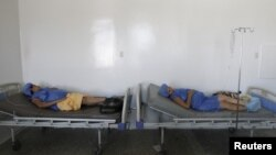 Pregnant women lay on beds without sheets during their labor at a maternity hospital in Maracaibo, Venezuela, June 19, 2015.