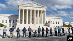 File - As the Supreme Court begins its new term, pro-life advocates hold a prayer vigil on the plaza of the High Court in Washington, October 2014.