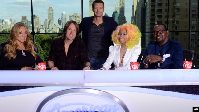 This photo provided by Fox, American Idol host Ryan Seacrest, center, poses with judges, from left, Mariah Carey, Keith Urban, Nicki Minaj and Randy Jackson, Sept. 16, 2012 in New York.