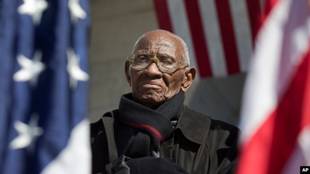 Richard Overton, the oldest living WWII veteran, listens during a ceremony attended by President Obama marking Veteran's Day, Nov. 11, 2013.