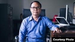 Aun Pheap, a former reporter at the Cambodia Daily who sought political asylum in the United States, faces up to two years in prison on a trumped-up charge of incitement to commit a felony. (Courtesy photo of Cambodia Daily)