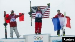Canada's second placed Mike Riddle, first placed David Wise of the U.S. and France's third placed Kevin Rolland (L-R) celebrate on the podium after the men's freestyle skiing halfpipe finals at the 2014 Sochi Winter Olympic Games in Rosa Khutor, Russia, F