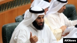 FILE - Former Kuwaiti Minister of Justice, Islamic endowments and Islamic Affairs Nayef al-Ajmi speaks at a session of Kuwait's National Assembly. Ajmi resigned in the wake of accusations by a senior U.S. official that he was enabling terrorism.