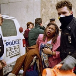 A New York City police officer helps a victim of the February 26, 1993, bomb attack at the World Trade Center