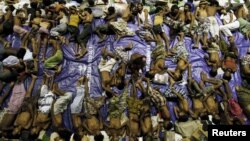 Migrants believed to be Rohingya rest inside a shelter after being rescued from boats at Lhoksukon in Indonesia's Aceh province, May 11, 2015.