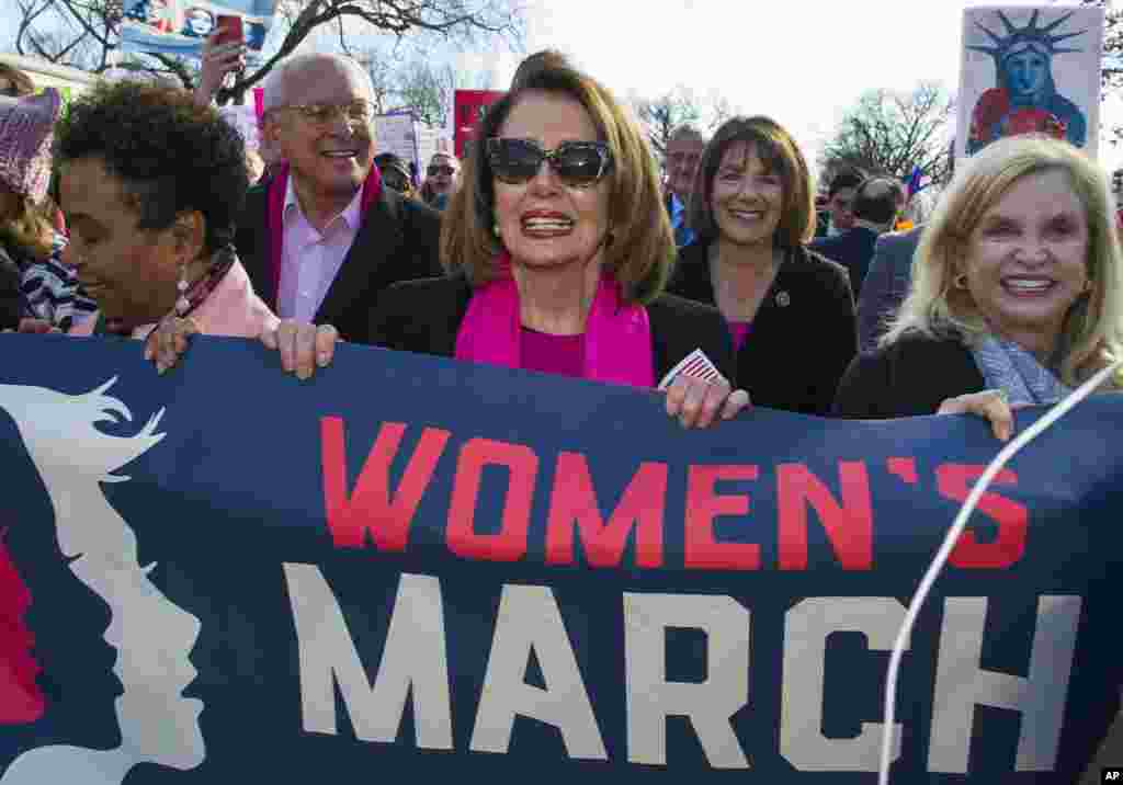 House Minority Leader Nancy Pelosi, D-Calif., center, Rep. Susan Davis, D-Calif, background center right, and Rep. Carolyn Maloney, D-N.Y., right, participate in the Women's March walk to the White House in Washington, Jan. 20, 2018.