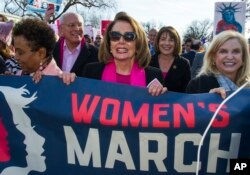 House Minority Leader Nancy Pelosi, D-Calif., center, Rep. Susan Davis, D-Calif, background center right, and Rep. Carolyn Maloney, D-N.Y., right, participate in the Women's March walk to the White House in Washington, Jan. 20, 2018. On the anniversary of President Donald Trump's inauguration, people participating in rallies and marches in the U.S. and around the world Saturday denounced his views on immigration, abortion, LGBT rights, women's rights and more.