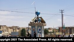 A Taliban flag flies in the square of Ghazni city after fighting between Taliban and Afghan security forces in Ghazni, southwest of Kabul, Afghanistan, Thursday, Aug. 12, 2021. The Taliban captured the provincial capital near Kabul on Thursday, the…