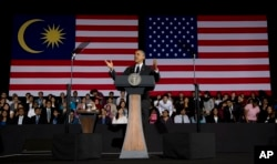 FILE - President Barack Obama gestures as he speaks during a town hall meeting at Malaya University in Kuala Lumpur, Malaysia, Sunday, April 27, 2014.