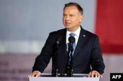 FILE - Polish President Andrzej Duda speaks to a crowd during an event in Gdansk-Westerplatte, Sept. 1, 2020.