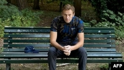 TOPSHOT - This handout picture posted on September 23, 2020 on the Instagram account of @navalny shows Russian opposition leader Alexei Navalny sitting on a bench in Berlin. - Russian opposition leader Alexei Navalny, who the West believes was…