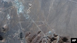 This Nov. 4, 2020, satellite photo by Maxar Technologies shows Iran's Fordo nuclear site. Iran has begun construction on a site at its underground nuclear facility at Fordo, satellite photos obtained Friday, Dec. 18, 2020, by the Associated Press show.
