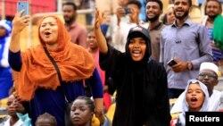 Fans react during Sudan's first women's league soccer match at the Khartoum stadium, Khartoum, Sudan, Sept. 30, 2019.