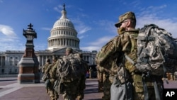 FILE - National Guard troops reinforce security around the U.S. Capitol ahead of expected protests leading up to Joe Biden's inauguration as president, in Washington, Jan. 17, 2021.