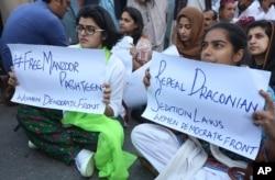 Women protest demanding the release of human rights activist Manzoor Pashteen, in Karachi, Pakistan, Jan. 28, 2020.