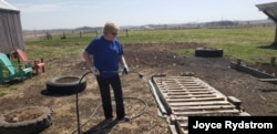 Joyce Rydstrom of Alta, Iowa, had to shut the doors to her hair salon in March amid the coronavirus pandemic. These days, she spends some of her free time gardening.