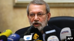 (FILES) In this file photo taken on February 17, 2020, Iranian Parliament Speaker Ali Larijani gives a press conference at the Iranian embassy in the Lebanese capital Beirut.