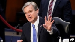 "FBI Director Christopher Wray testifies before the Senate Judiciary Committee on Capitol Hill in Washington, March 2, 2021. Wray is condemning the Jan. 6 riot at the Capitol as ""domestic terrorism."""